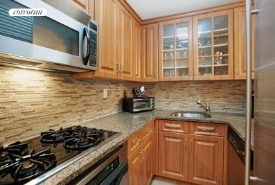 Beautifully renovated kitchen with pass thru.