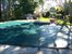 huge free form pool with hot tub