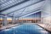 Glass-Enclosed Rooftop Swimming Pool