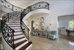 Marble floors and custom built stair case great you as you walk through the door