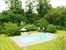 landscaped yard with pool