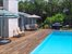 heated pool and wood deck