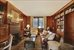 Library with wood paneling and wet bar