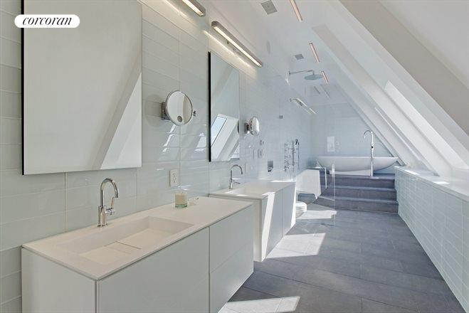 Just look at that modern open bathroom with light streaming in.