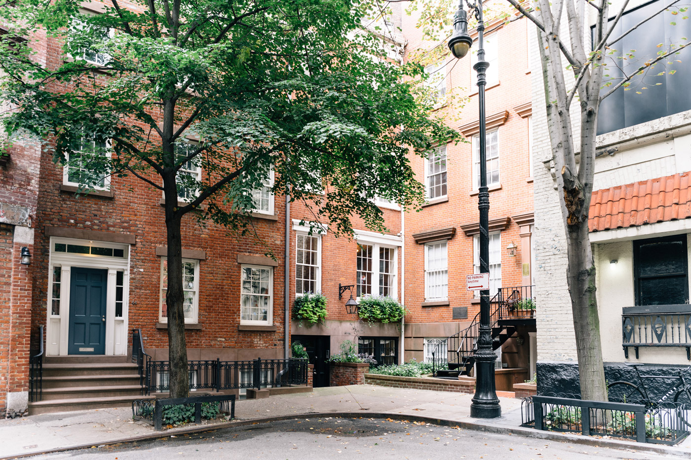 Brick townhouses on tree-lined streets in West Village