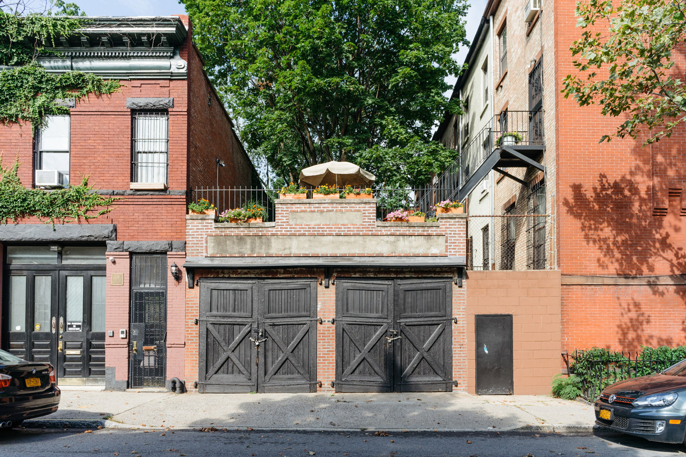 "Red brick building with a garden on the roof in Clinton Hill"" style="