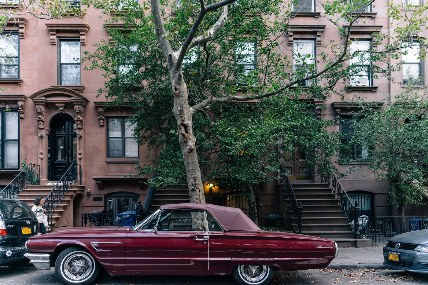 Thunderbird convertible parked outside a Cobble Hill townhouse