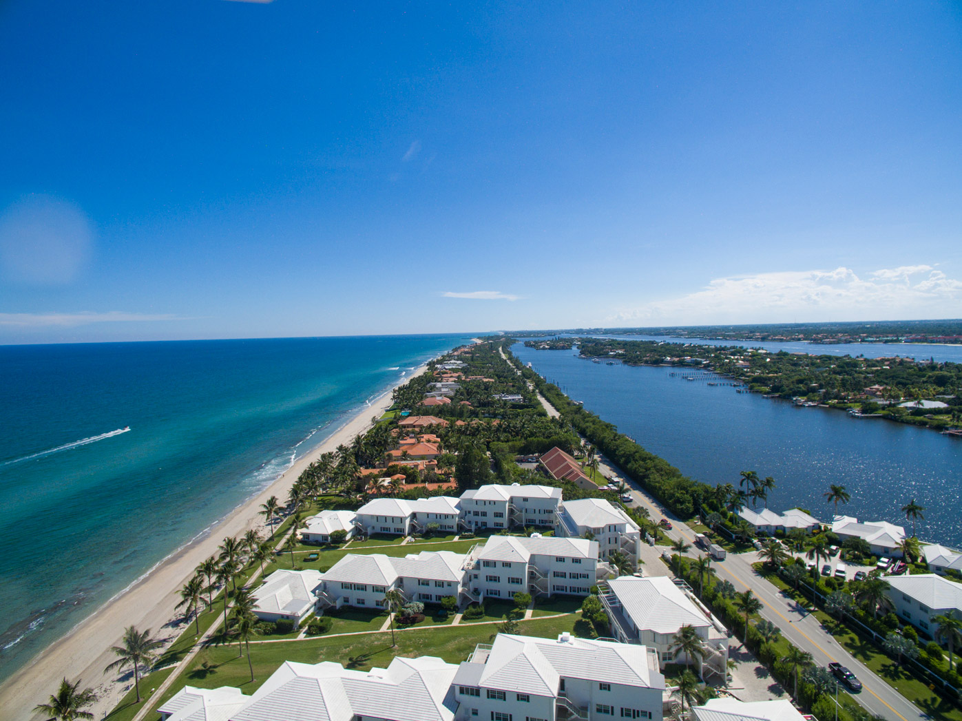 "An aerial view of waterfront houses in Manalapan"" style="