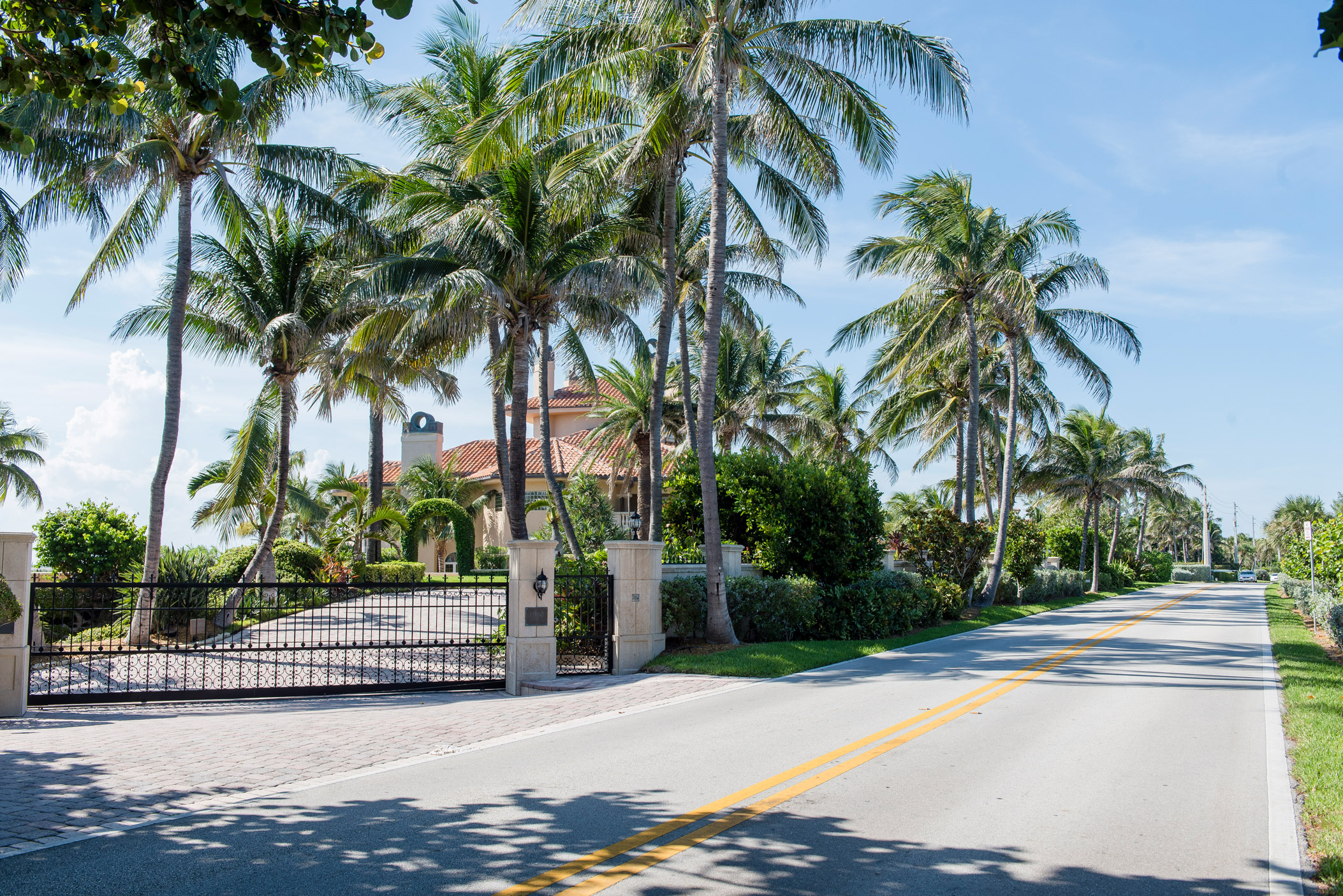 "Beautiful large houses along a residential street in Manalapan"" style="