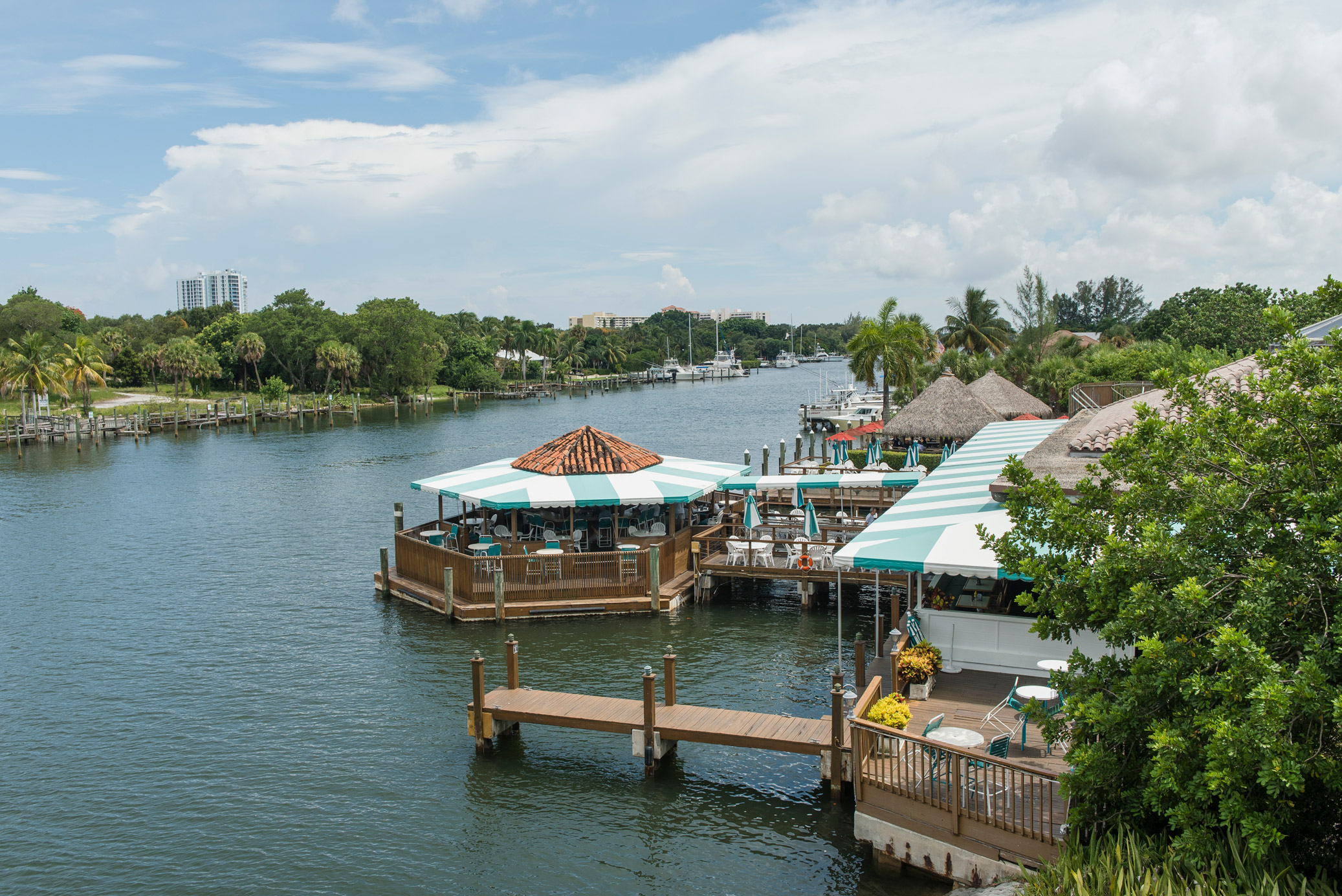 "A restaurant that sits on a canal in North Palm Beach"" style="
