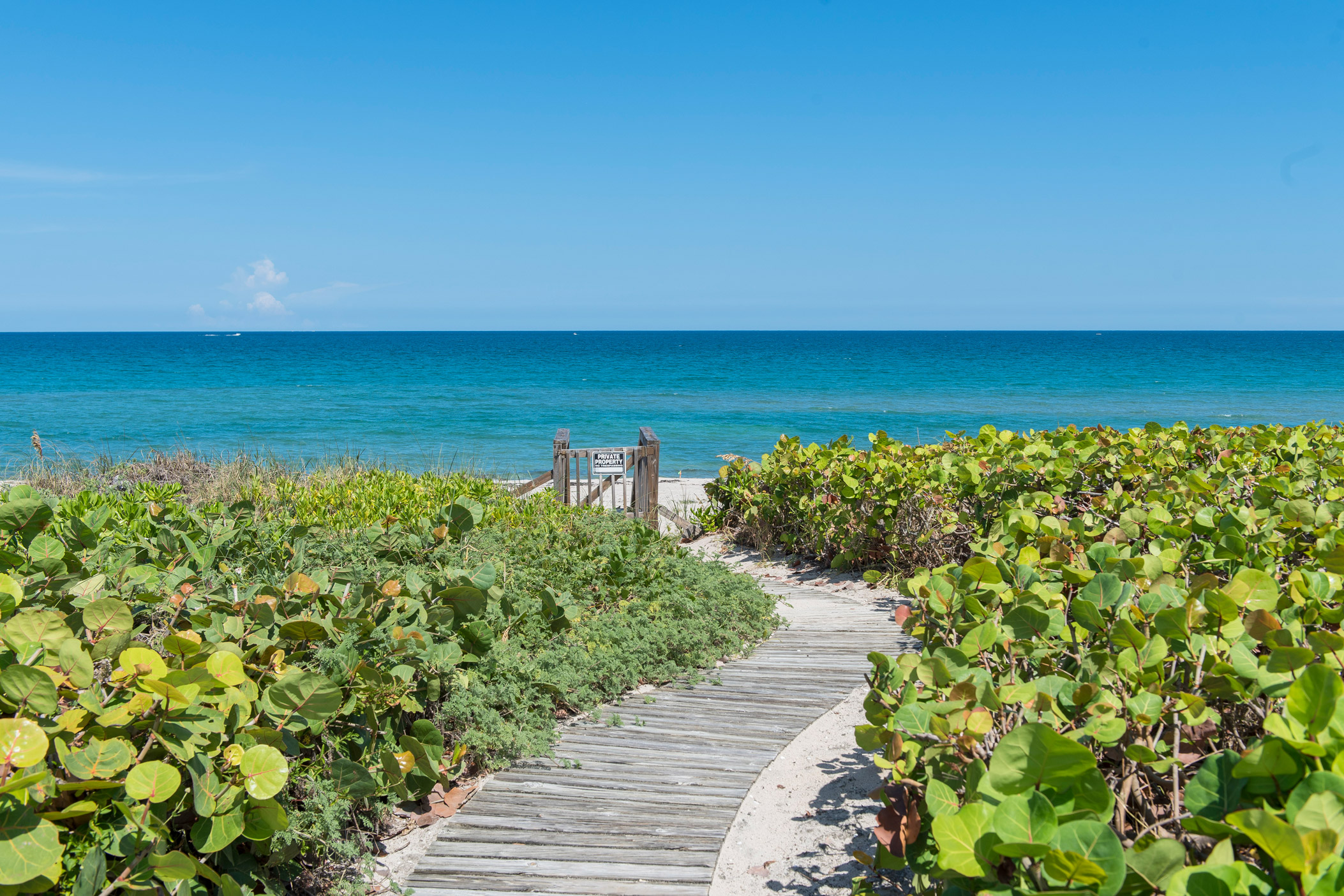 "A walkway down to the beach in Ocean Ridge"" style="