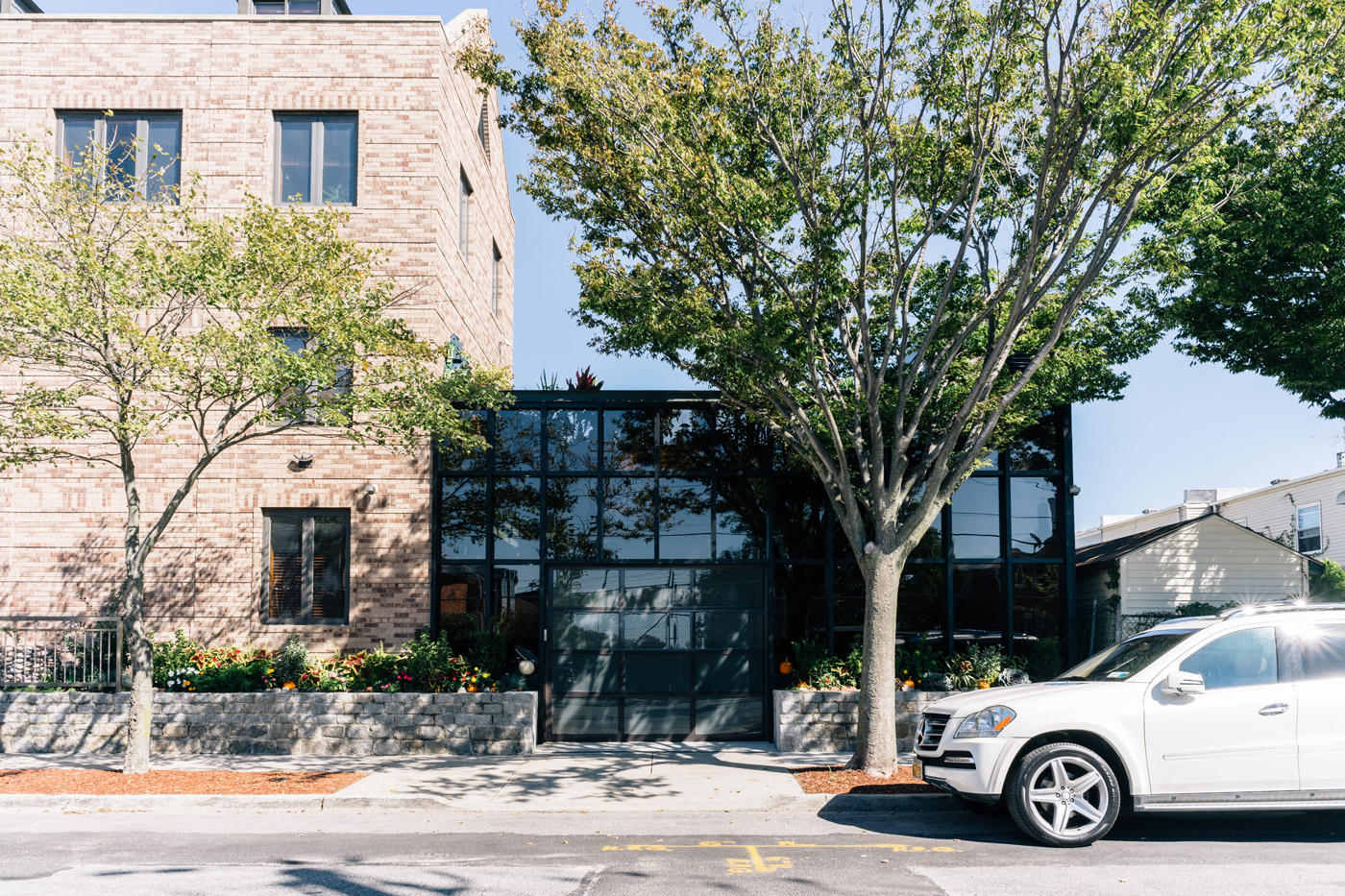 """Glass building next to a brick building in Sea Gate"""" style="""