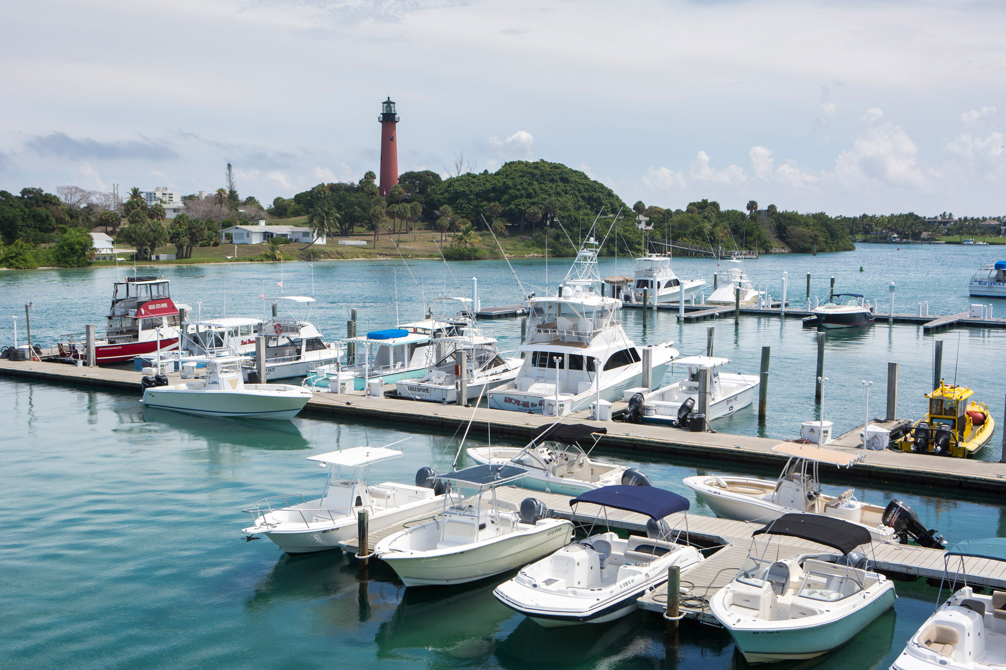 "A large amount of fishing boats and yachts docked in Tequesta"" style="