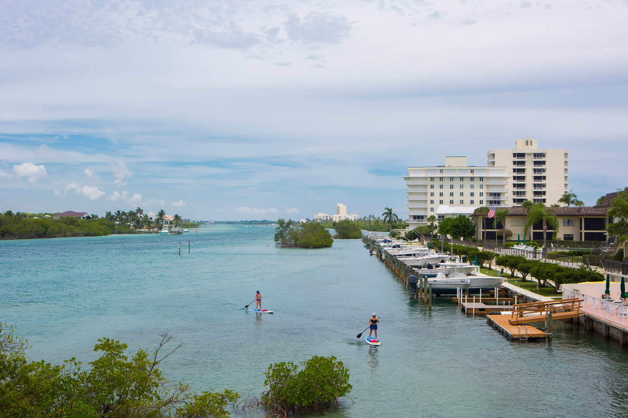 "People paddle boarding down the canal in Tequesta"" style="
