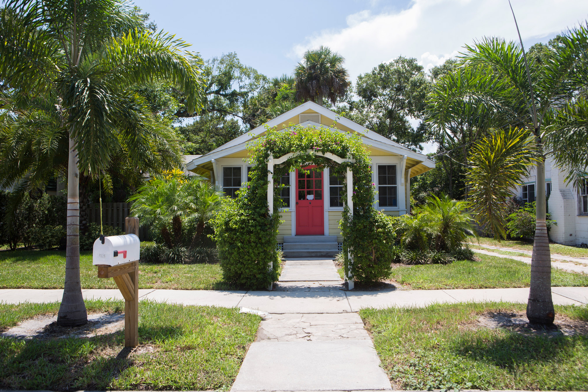 A Quaint Yellow House With Red Door In Vero Beach Style